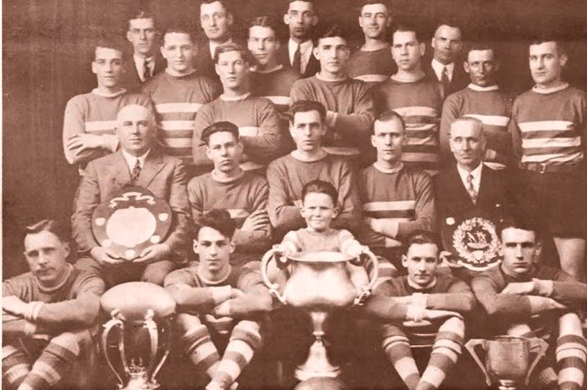 The Caledonia English rugby team captured the 1929 Eastern Canadian championship. Members of the team are shown with the championship trophy. From left, front row, Graham Crocker, Bob Jackon, Chas McVicar Jr. (mascot), Broph MacDonald and Geo Nicholson; second row, Chas McVicar Sr. (manager), Melvin Sheppard, Dan Nicholson, Geo MacNeil and Ewan Hillier; third row, Tom Jackson, Jim Driscoll, (Toots) Boutilier, Jim Leslie, Louis Morris, Clarence MacLean and Sandy MacMullin; back row, Win Wilton, Stan Scott, Hun Lawley, Neil Nicholson, Jut Wadman and Jas Ferguson (treasurer). CONTRIBUTED