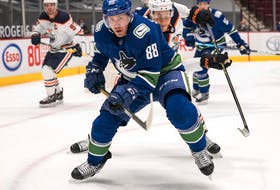 May 3, 2021; Vancouver, British Columbia, CAN; Edmonton Oilers forward Jesse Puljujarvi (13) chases after Vancouver Canucks defenseman Nate Schmidt (88) in the first period at Rogers Arena. Mandatory Credit: Bob Frid-USA TODAY Sports