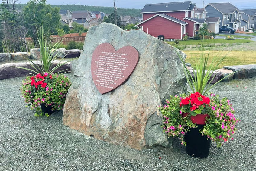 """The wording on the dedication plaque in the reflection heart, prepared by Noah's family, reads, """"Noah was a little boy with a big heart and huge love of life. He loved to play, explore and have fun. He was funny, adventurous, gentle, outgoing and truly enjoyed making others smile. Noah was a boy who found joy in everything and who brought joy to everyone who knew him. He had a sweet and generous nature and made friends everywhere he went. He leaves a legacy of kindness and love; his life a reminder to make the most of every moment and to always show compassion and caring to others as he did. As you play here today, please remember to have fun and to be kind, just as Noah would have."""""""