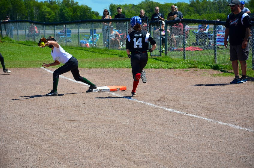 Solen Trainor of the P.E.I. Under-14 Whitecaps records the out at first base to retire the Riptide's Brooklyn Fraser during a game in the Red Isle Realty Under-16 Atlantic Classic fastpitch tournament. The Whitecaps are based out of the ball diamonds behind the North Shore Community Centre. - Jason Simmonds