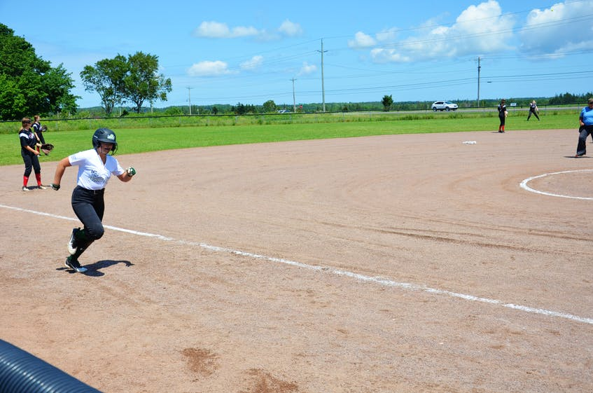 Ava Hodder of the P.E.I. Under-14 Whitecaps races towards home plate in a game versus the Riptide team in the Red Isle Realty Under-16 Atlantic Classic fastpitch tournament in Richmond on July 24. Hodder would successfully score standing up. - Jason Simmonds
