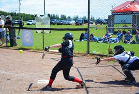Lilly Keefe of the Riptide team swings at a pitch during an all-P.E.I. clash against the P.E.I. Under-14 Whitecaps in the Red Isle Realty Under-16 Atlantic Classic fastpitch tournament in Richmond on July 24. Whitecaps catcher Madison Gauthier awaits the pitch. A total of six teams competed in the three-day event. The Saint John Southern Black Bears returned to New Brunswick with the gold medal. The Newfoundland provincial Under-14 Selects took home the silver medal. For results from the semifinal and final games, see the scoreboard on B2.