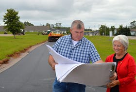 Dean Lewis, left, manager of planning and development with the Town of Cornwall, looks over plans for a series of trails and active transportation paths with Mayor Minerva McCourt.