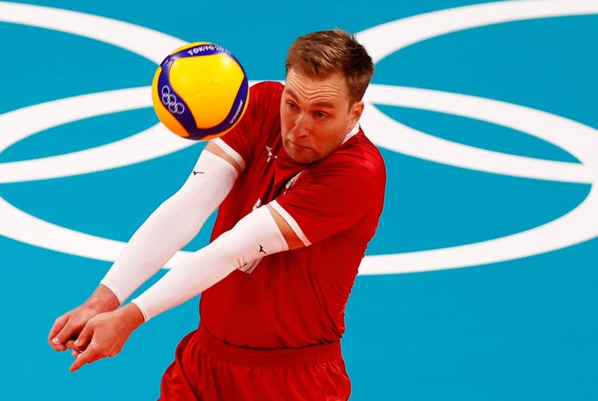 Blair Bann of Canada passes a ball against Italy on July 24, 2021, in Pool A action in the Tokyo 2020 Olympics at Ariake Arena, Tokyo, Japan.