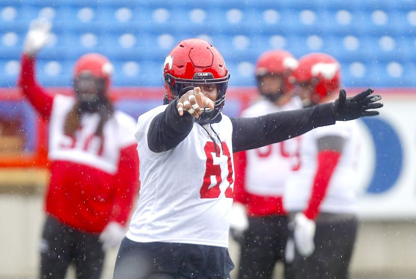 Right back at ya, big man! Calgary Stampeders OL Ucambre Williams has re-signed with the Red & White. File photo by Darren Makowichuk/Postmedia.