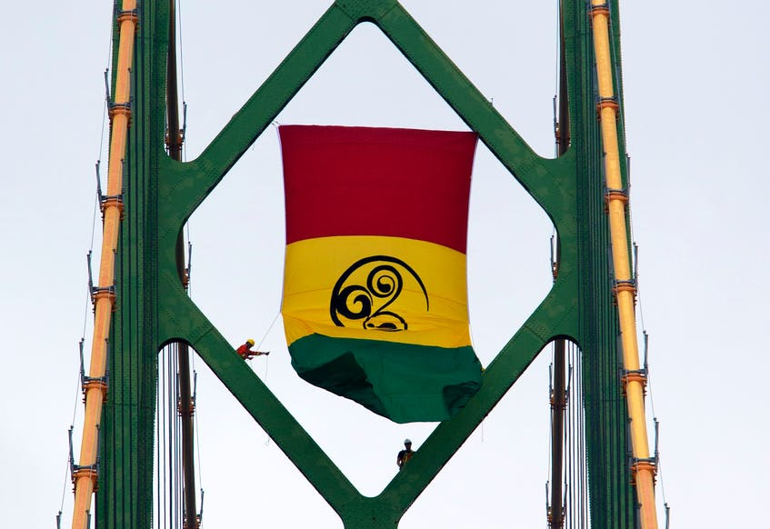 The colours on the flag each have significance. The symbol at the centre is Wilson's interpretation of the West African Adinkra symbol, the Sankofa. -Tim Krochak