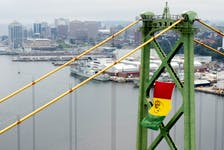 FOR NEBAL STORY: To commemorate Emancipation Day on Sunday, August 1, Halifax Harbour Bridges (HHB) hang the African Nova Scotia flag on one of the towers of the Macdonald Bridge Tuesday July 27, 2021. The flag was designed in 2012 by African Nova Scotian artist Wendie L. Wilson.  TIM KROCHAK PHOTO