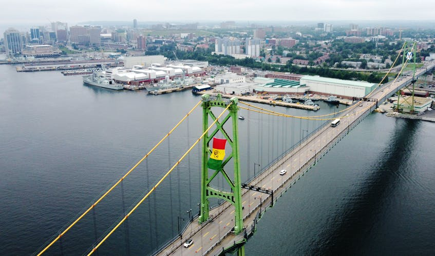 To commemorate Emancipation Day, which falls on Aug. 1, Halifax Harbour Bridges (HHB) put up the African Nova Scotia flag on one of the towers of the Macdonald Bridge on Tuesday, July 27, 2021. The flag was designed in 2012 by artist and educator Wendie L. Wilson. - Tim Krochak
