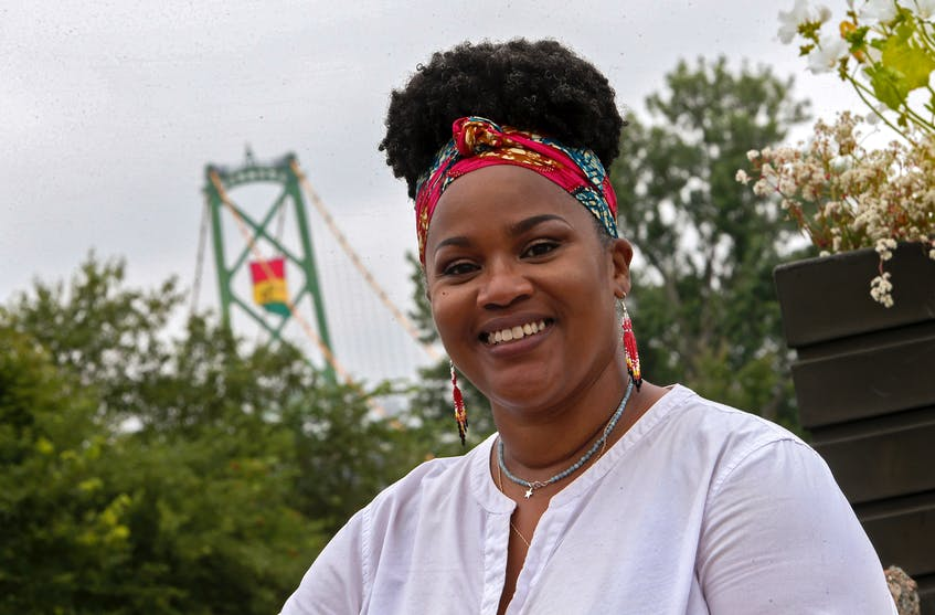 Wilson said she hoped the flag will be an opportunity for African Nova Scotian students to feel proud of their heritage and culture. She is seen at the Macdonald Bridge shortly after the flag was put up. - Tim Krochak