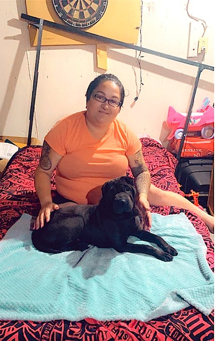 Crystal Ayre, formerly of Whitney Pier and now of Moncton, N.B., with her son's Chinese Shar-Pei emotional support dog Jeteye. Ayre said after visiting in the area they were headed home July 13 when Jeteye got spooked by something and is now facing a long road of recovery after 12 days on the loose that included falling over two 50-foot cliffs and fighting riptides. CONTRIBUTED.