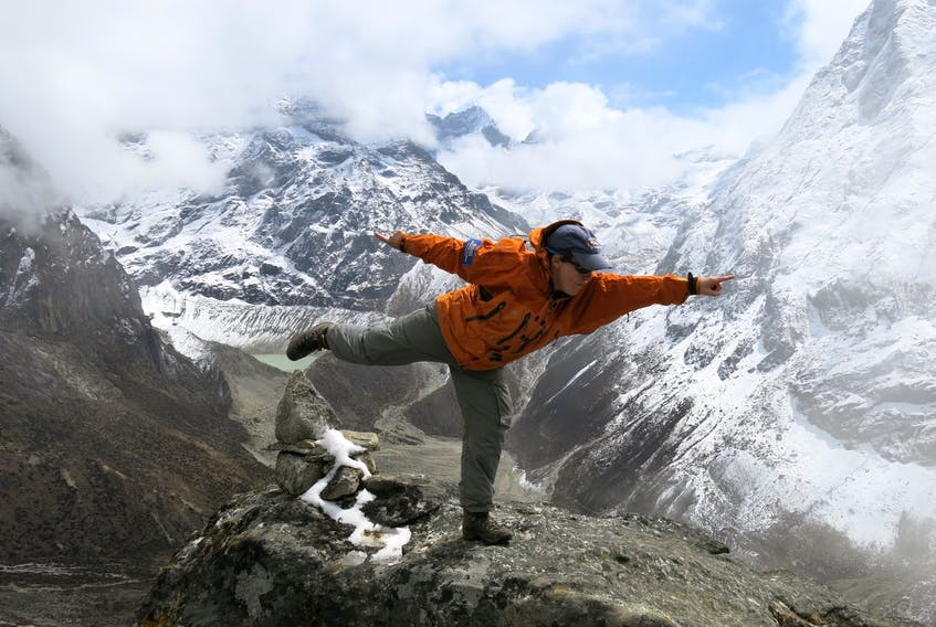 Dr. TA Loeffler - pictured here high atop Mount Everest - still loves to play. Loeffler, who grew up in Alberta and now lives in St. John's, NL, where she is a professor at Memorial University, says Canadian kids have fewer opportunities to enjoy the free-range play she had as a child.