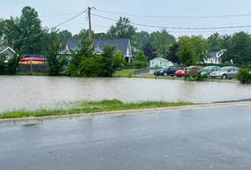 The parking lot adjacent to Victoria Park and the Hants Aquatic Centre was completely submerged July 27 following a sudden storm in Windsor. JENNIFER DANIELS
