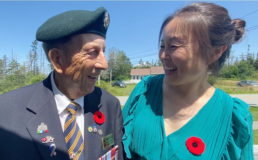 Korean War veteran Nelson Deveau and Korean-born Yarmouth resident Sonia Park-Lawrence share smiles as they exchange phases in Korean following a special ceremony honouring veterans of the Korean War that was held by the Wedgeport Legion Branch 155 on July 24. TINA COMEAU