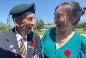 Korean War veteran Nelson Deveau and Korean-born Yarmouth resident Sonia Park-Lawrence share smiles as they exchange phases in Korean following a special ceremony honouring veterans of the Korean War that was held by the Wedgeport Legion Branch 155 on July 24. TINA COMEAU • TRICOUNTY VANGUARD
