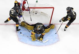 File photo/ Marc-Andre Fleury #29 of the Vegas Golden Knights gets assistance from Nicolas Roy #10 and Nick Holden #22 while blocking a shot by Joel Armia #40 of the Montreal Canadiens during the second period in Game Five of the Stanley Cup Semifinals at T-Mobile Arena on June 22, 2021 in Las Vegas, Nevada. The Canadiens beat the Golden Knights 4-1.