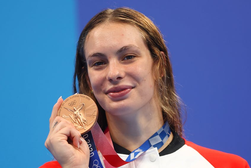 Penny Oleksiak of Canada poses with her bronze medal from the women's 200m freestyle swimming event at the Tokyo Aquatics Centre in Tokyo, Japan on Wednesday, July 28, 2021.