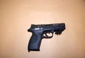 Andrew Hudder had this loaded 9 mm Smith & Wesson pistol in a satchel strapped to his chest when police arrested him in April.