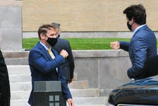 Premier Andrew Furey (left) greets Prime Minister Justin Trudeau in St. John's on July 29 upon the PM's arrival at the Confederation Building. Joe Gibbons • The Telegram