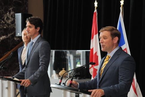 Premier Andrew Furey (right) speaks to reporters in St. John's on July 29. Looking on are Prime Minister Justin Trudeau (centre) and federal Natural Resources Minister Seamus O'Regan. Joe Gibbons • The Telegram