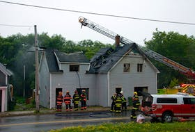 Firefighters battle a vacant house fire on Main Street in Trenton.