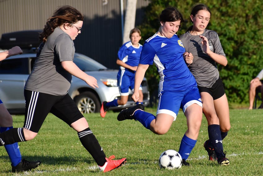 Whitney Pier's Ryelyn Gabriel, middle, prepares to take a shot on goal as Northside Storm defenders pressure during Cape Breton and District Soccer League under-13 girls action at Dominion Street Field in Whitney Pier recently. The teams tied 2-2. JEREMY FRASER • CAPE BRETON POST