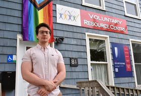 Connor Kelly, tenant network coordinator with P.E.I. Fight for Affordable Housing, stands outside the Voluntary Resource Centre in Charlottetown.