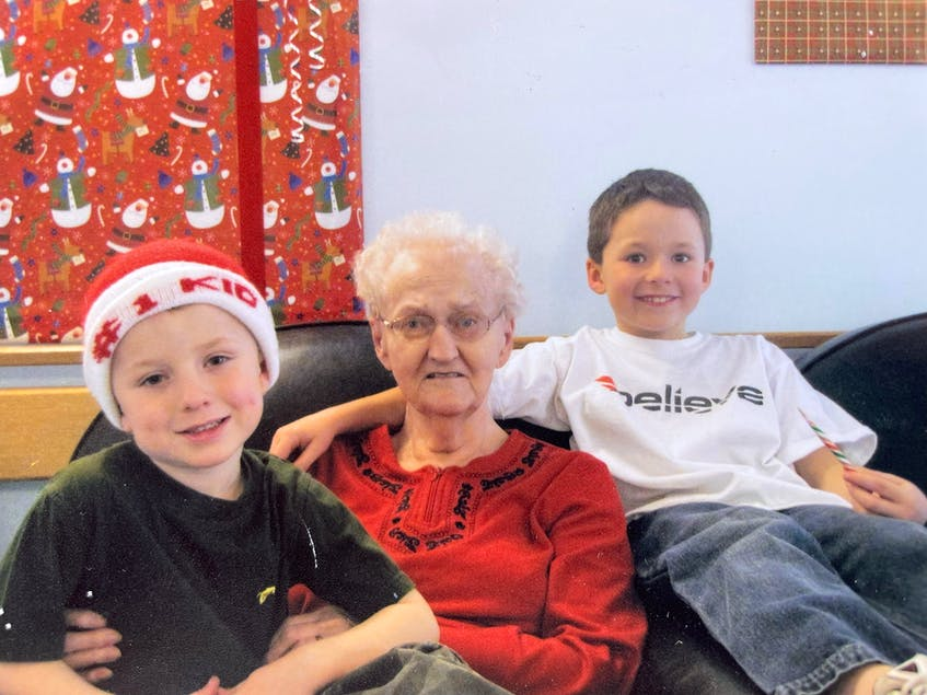 Alex and Ben Kennedy with their nan, Ruby MacLeod, at her nursing home. During Ruby's illness, the kids spent countless hours visiting her.