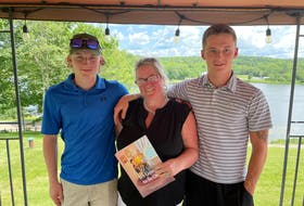 Marie Kennedy and her sons Ben, left, and Alex, recently wrote and self-published the children's book, It's Going to Be OK, about their journey with Alzheimer's. The Antigonish, N.S. family experienced Alzheimer's first-hand after Marie's mother was diagnosed with the disease while Alex and Ben were still young children.