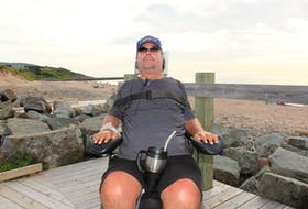 In this 2018 file photo, Callum MacQuarrie sits in his motorized wheelchair on the boardwalk at Inverness beach. In the background is the breakwater where he broke his neck in a 1995 diving accident. As co-chair of the Inverness County Accessibility Committee, he helped make Inverness beach the most accessible beach in Atlantic Canada. Chris Connors • Cape Breton Post