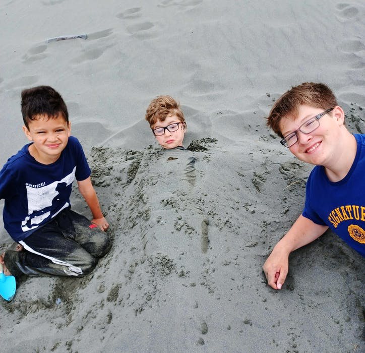 Some things to take your mind off phones, internet and TV: From left, Nikolas Legge, Reed French and Elliott MacDonald in Salmon Cove. — Janice Wells photo