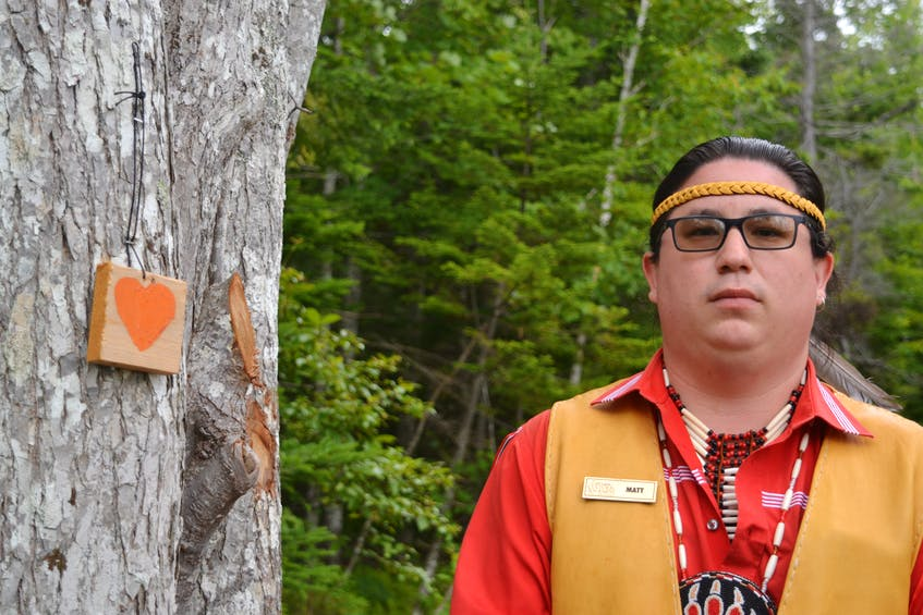 A total of 215 orange hearts were added along the trail on Goat Island in Eskasoni First Nation after the remains of 215 children were recovered at the site of the former Kamloops Indian Residential School in British Columbia. The hearts give tour guide Matthew Patles an opportunity to talk about residential schools with visitors who, sometimes, haven't heard of them. ARDELLE REYNOLDS/CAPE BRETON POST - Saltwire network