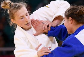 Before fighting Szofi Ozbas of Hungary on Tuesday in the 63-kg round of 32, he proceeded to grab Trajdos' shoulders, shake her repeatedly, then applied a hard back-and-forth face slap to her cheeks.