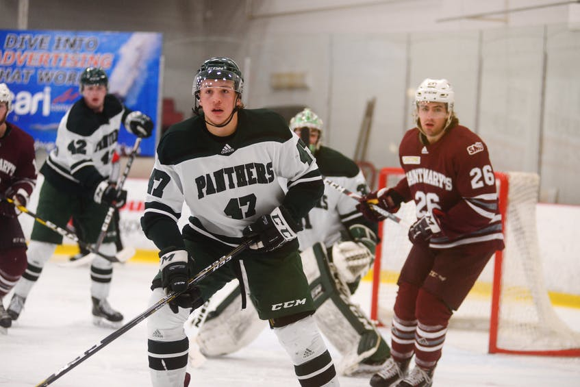 Defenceman Owen Headrick, centre, is coming back to Charlottetown to play his final year of eligibility with the UPEI Panthers in 2021-22. - Jason Malloy • The Guardian