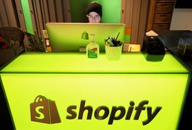 A Shopify employee three years ago at the company's former headquarters building in Ottawa. Work from home will continue into 2022..
