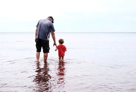 Tim Jess and his nephew, Darwin Fiene, explore the beach near his cottage home in Linden, N.S. For Jess, there's nothing quite like the cottage.
