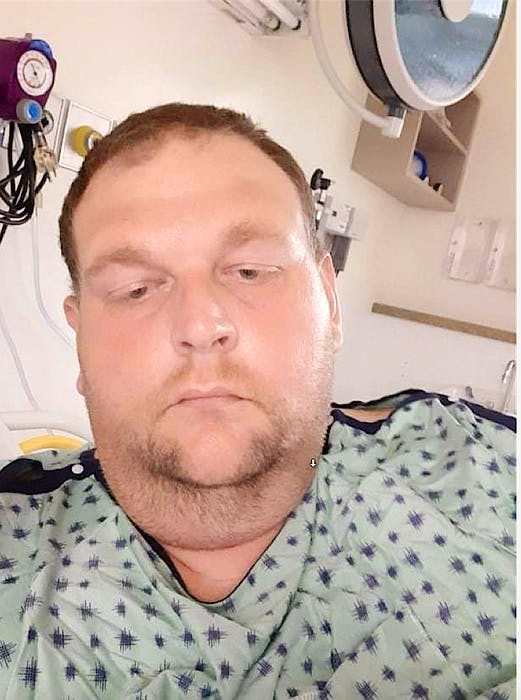 Garrie Waldron, 44, shown while at the QE2 Health Sciences Centre in Halifax after passing out in his electric wheelchair while crossing Welton Street in Sydney, June 29. CONTRIBUTED