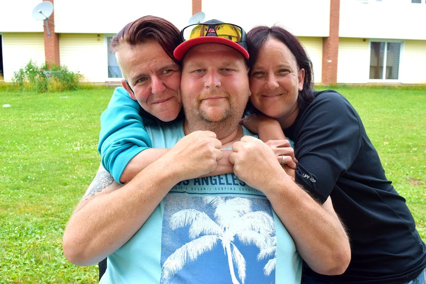 Garrie Waldron, 44, centre, diagnosed with esophageal adenoid carcinoma, a rare and aggressive cancer, is shown with Lorraine Lynk-MacLeod, left and her wife Tracey Lynk-MacLeod. Waldron was readmitted to hospital in Halifax on Wednesday. Sharon Montgomery-Dupe/Cape Breton Post