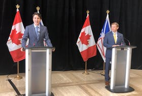 Prime Minister Justin Trudeau (left) announced a power rate mitigation deal alongside Newfoundland and Labrador Premier Andrew Furey, July 28, 2021 at the Confederation Building in St. John's.