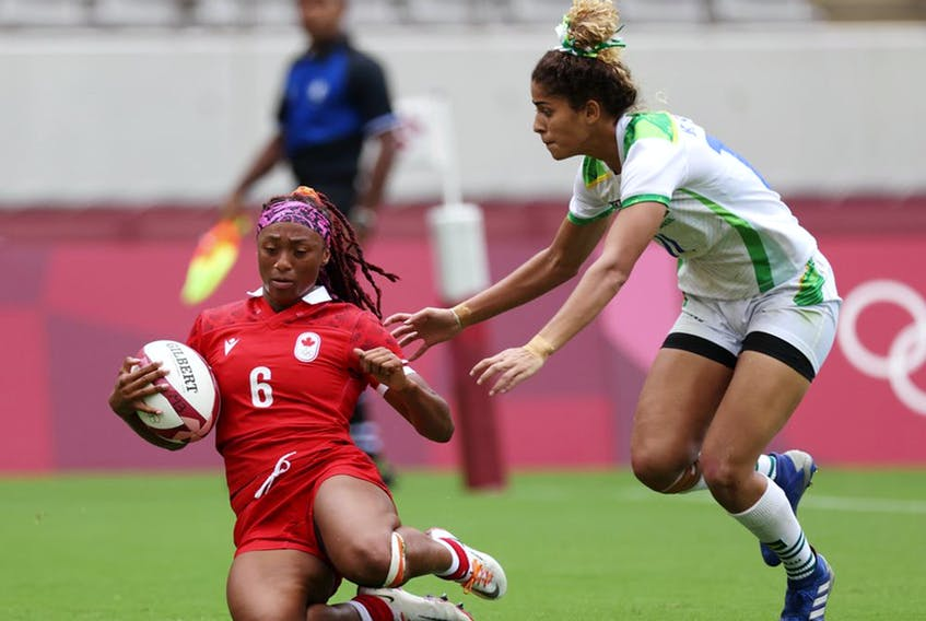 Charity Williams of Team Canada scores a try in the Women's pool B match between Team Canada and Team Brazil during the Rugby Sevens on day six of the Tokyo 2020 Olympic Games at Tokyo Stadium on July 29, 2021 in Chofu, Tokyo, Japan.