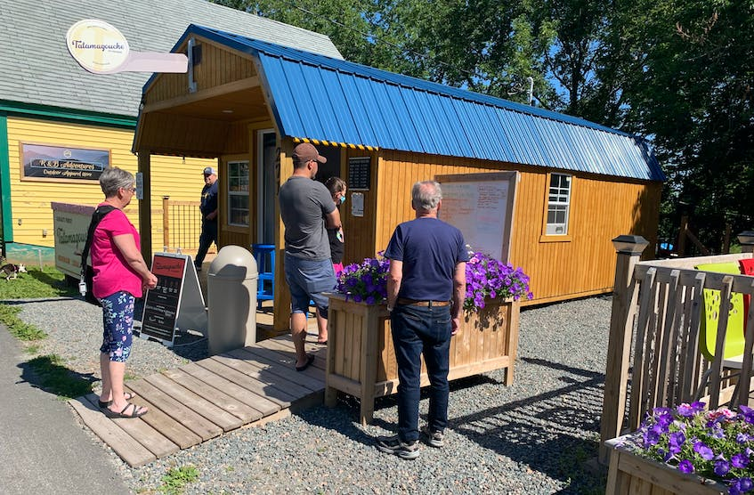 Lineups are common at Tatamagouche Ice Creamery. This group arrived at the shop 20 minutes before it opened for the day. - Bill Spurr