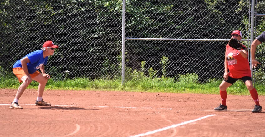 Darren 'Boo' Crowell gets ready for a close play at home while umpiring a recent Bud Light One Pitch League game at the Pictou Road Ballfield. - Richard MacKenzie