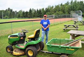 Bible Hill native Darren 'Boo' Crowell with the equipment he used to bring the Pictou Road Ballfield back to being in good playing condition.