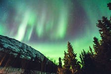 The Northern Lights or Aurora Borealis - seen here in the Yukon - occurs when charged particles stream from the sun during a solar flare or coronal mass ejection event intersects the Earth's magnetosphere. - Unsplash/Leonard Laub
