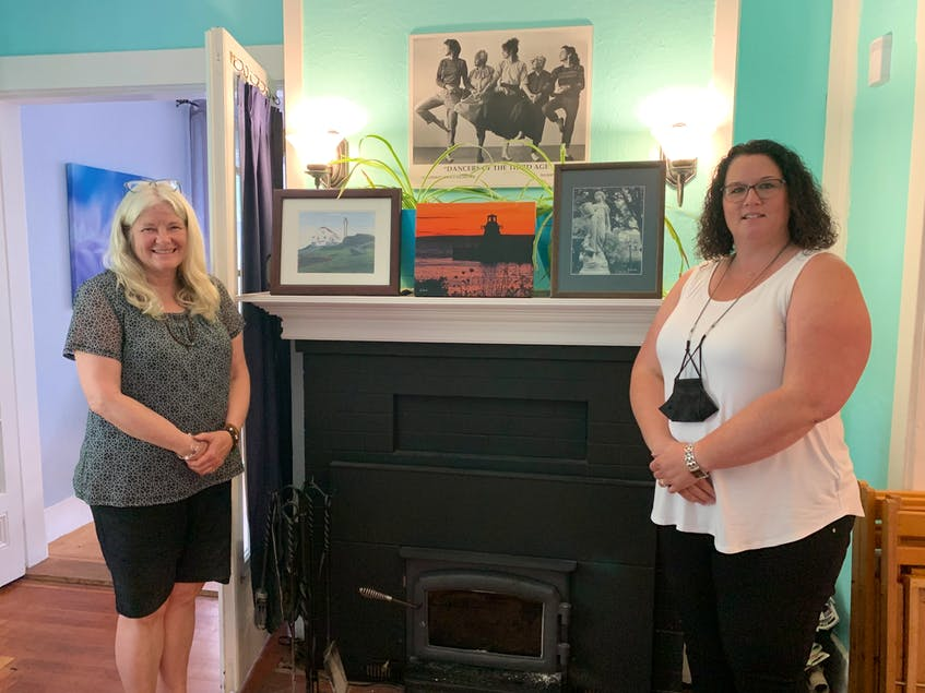 Artist Ann Clow with Shannon Watkins, Tri-County Women's Centre Coordinator. Clow, formerly from Yarmouth, donated a selection of her paintings to various facilities in Yarmouth.