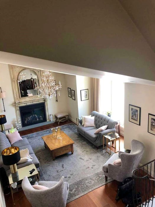 These pieces together are the perfect balance of a gold presence in this 'after' picture of an updated living room, while maintaining the client's traditional style, says designer Betty Ann Balcom