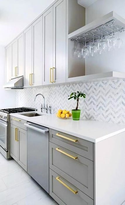 Stephanie Gouthro, owner of 3R Design Studio in Sydney, N.S., says adding gold hardware and knobs to kitchen cabinets is one way to add a hint of gold accents to your space.