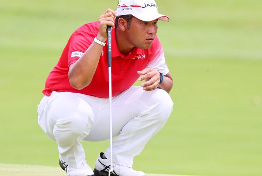 Hideki Matsuyama of Japan looks on.