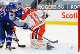 Toronto Maple Leafs forward Zach Hyman (11) scores a second period goal against Edmonton Oilers goaltender Mikko Koskinen (19) at Rogers Place on Jan 30, 2021.