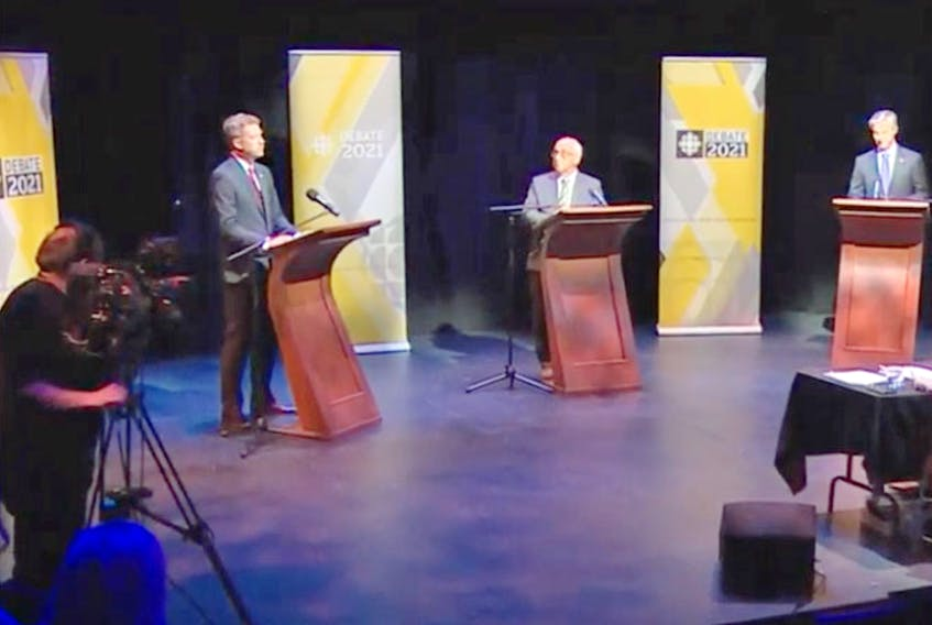From left, Liberal Leader Iain Rankin, NDP Leader Gary Burrill and PC Leader Tim Houston take part in a debate Wednesday, July 28, 2021, hosted by the CBC at Neptune Theatre in Halifax.