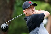 Mackenzie Hughes of Team Canada plays his shot from the 18th tee during the first round of the Men's Individual Stroke Play.